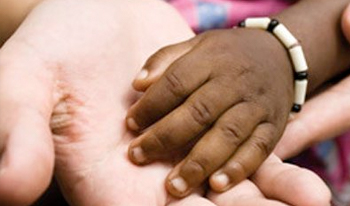 Closeup of a child's hand in an adult's hand