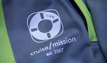 Closeup of Cruise With A Mission logo on a backpack